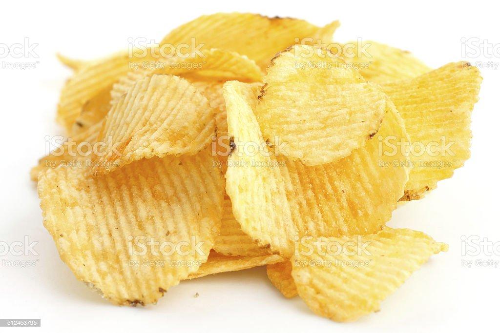 Crinkle cut crisps on white background. stock photo