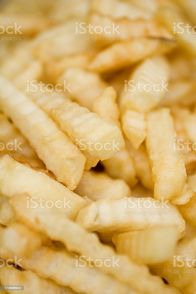 Crinkle-cut French fries royalty-free stock photo