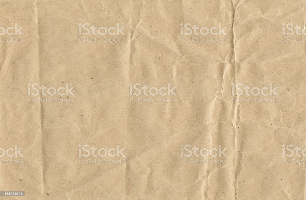 Crinkled brown paper stock photo