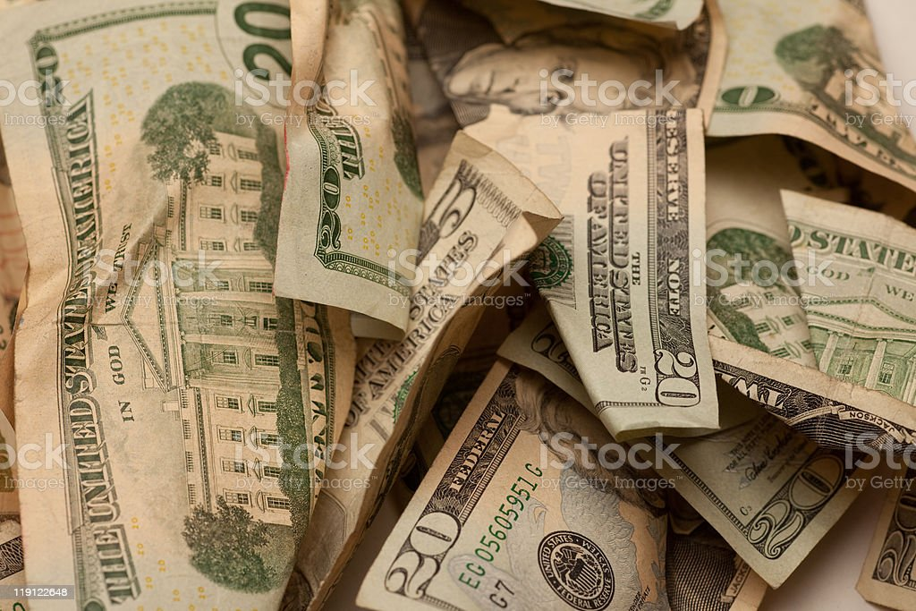 Crinkled us dollar bills closeup royalty-free stock photo