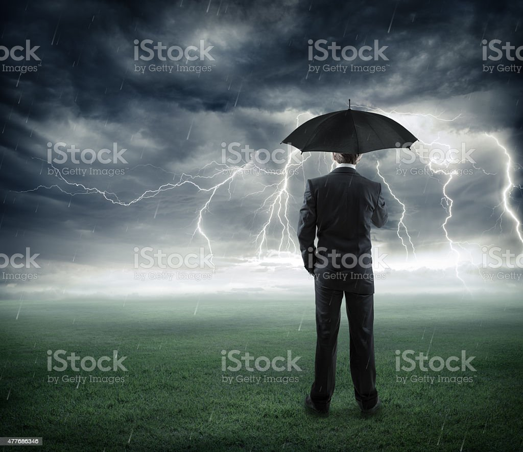 crisis and risk business - man with umbrella stock photo