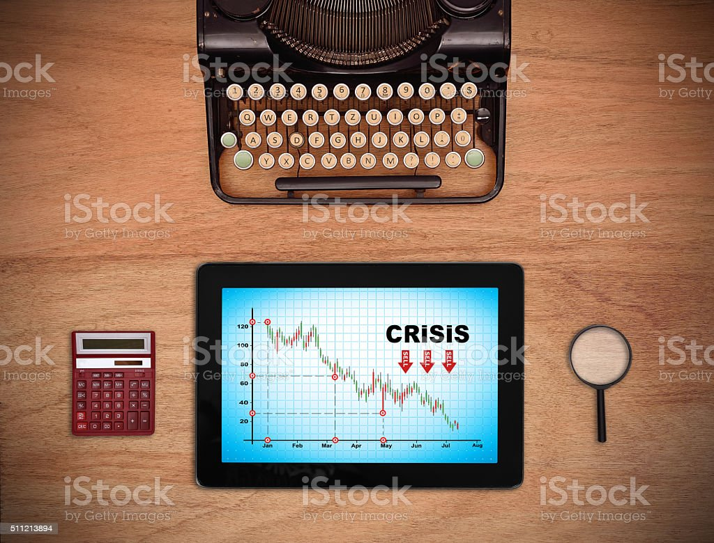 crisis chart on screen table stock photo