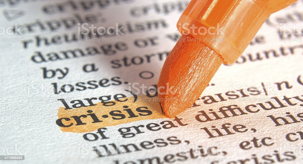crisis definition highligted in dictionary stock photo