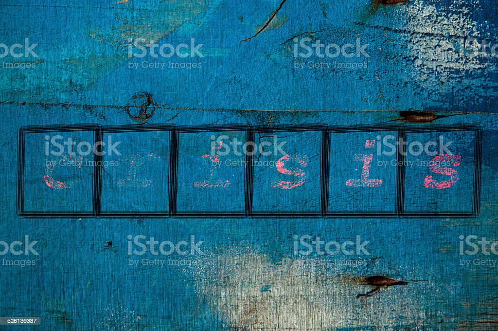 crisis writen on a wall background stock photo
