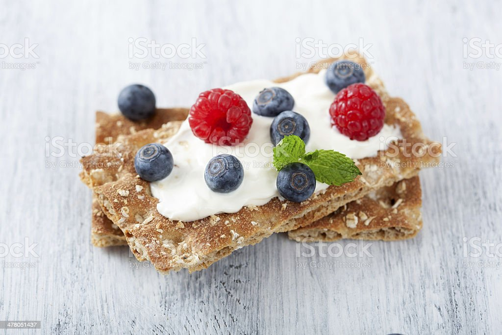 crisp bread with creme fraiche and berries royalty-free stock photo