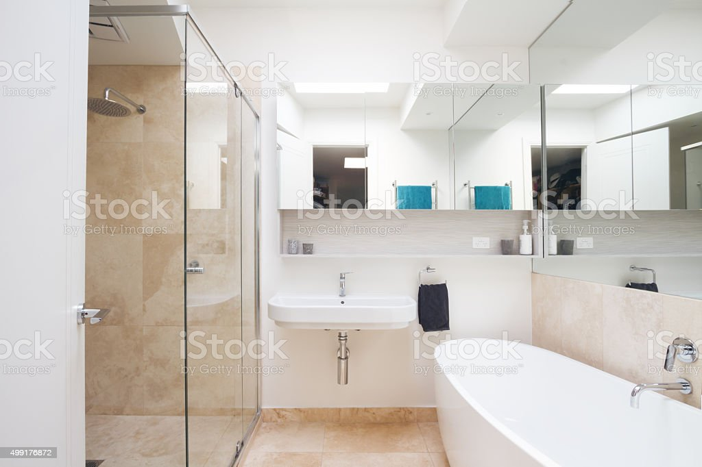 Crisp clean white and marble bathroom in luxury home stock photo