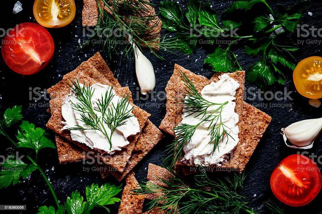 Crisp rye bread with soft curd cheese stock photo