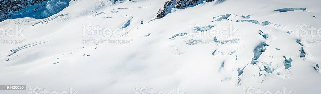 Crisp white winter snow on mountain glacier crevasses nature background stock photo