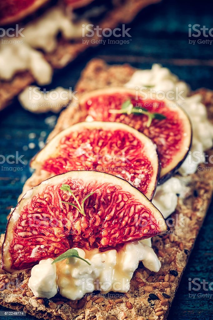 Crispbread with Cottage Cheese, Figs and Sweet Honey stock photo