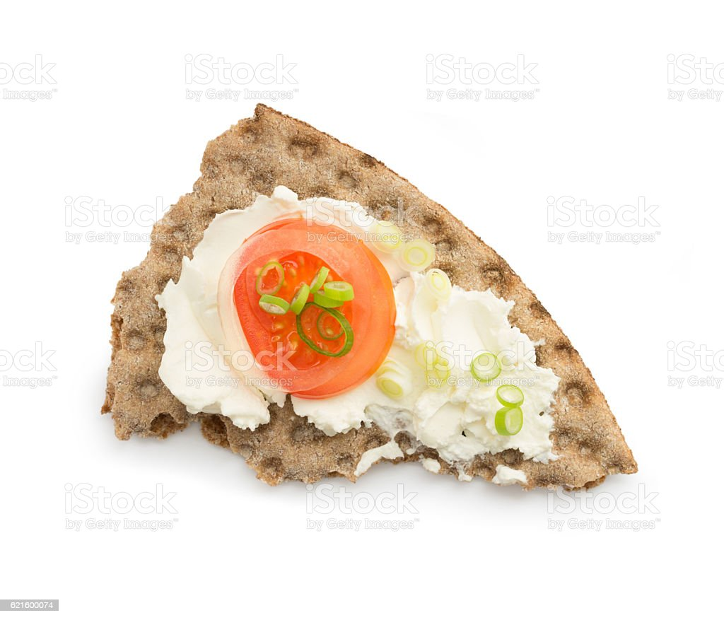 Crispbread with cream cheese tomatoe and onion decorated on white stock photo