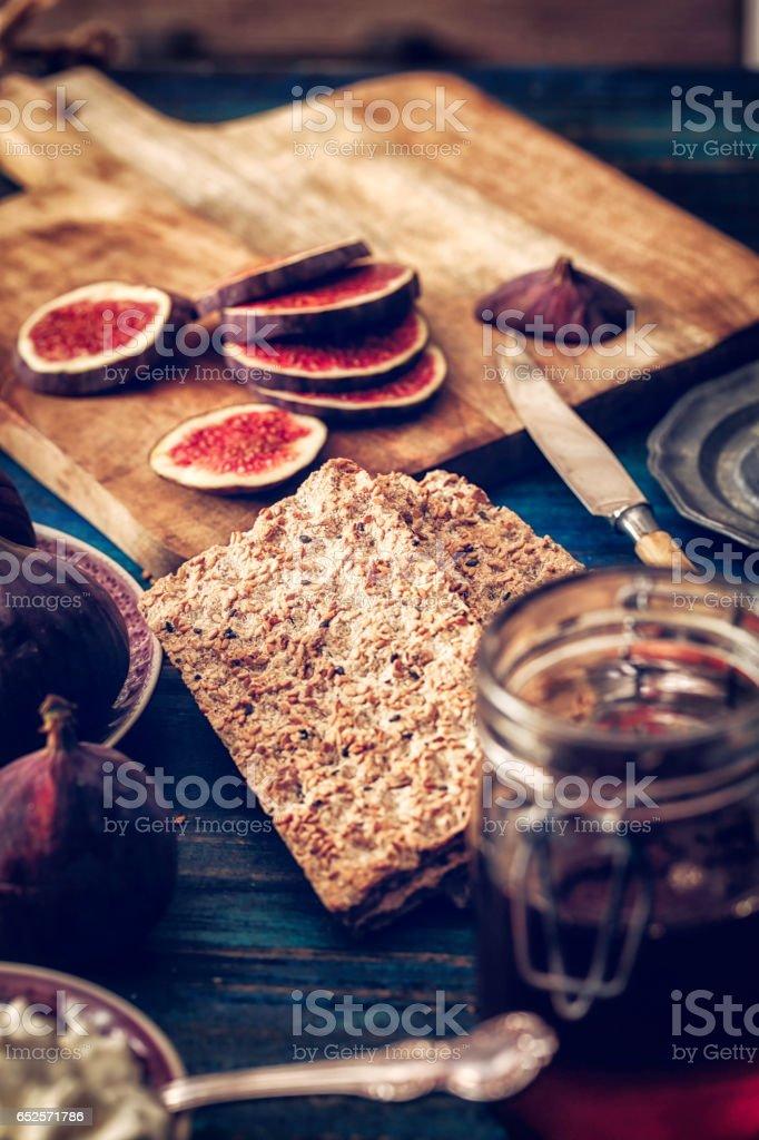 Crispbread with Serrano Ham, Cottage Cheese, and Figs stock photo