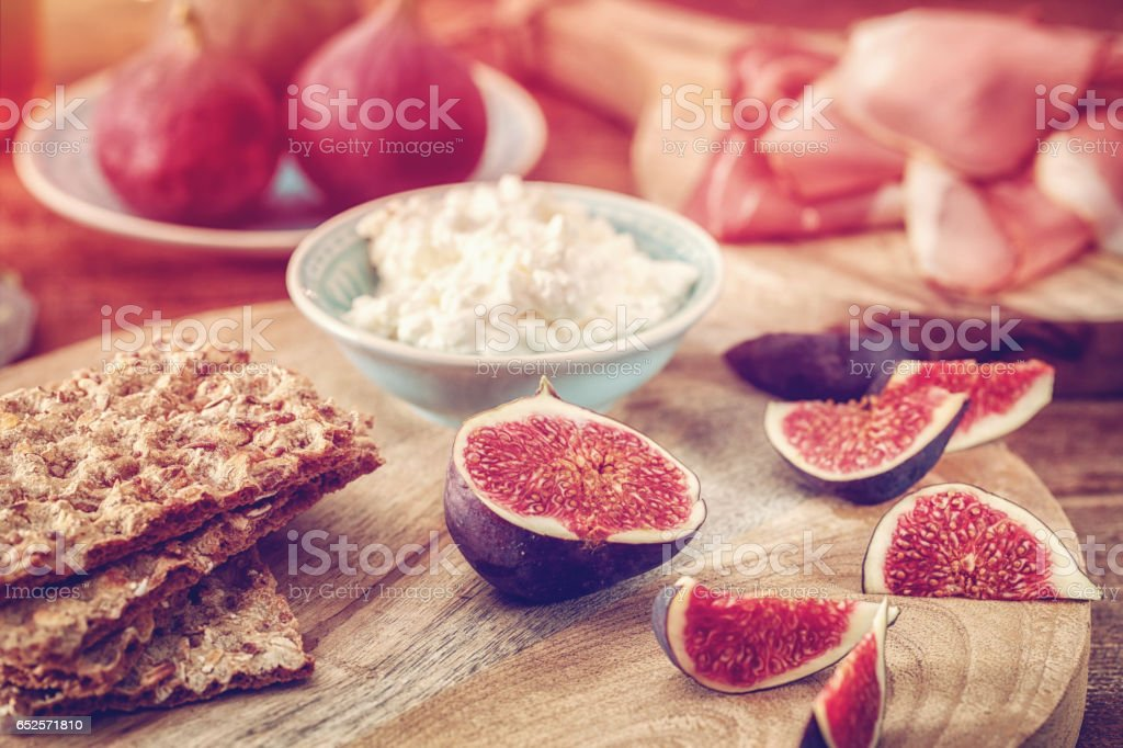 Crispbread with Serrano Ham, Cottage Cheese, and Figs stock photo