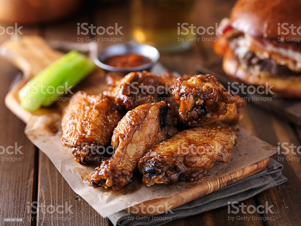 crispy barbecue chicken wings with celery stock photo