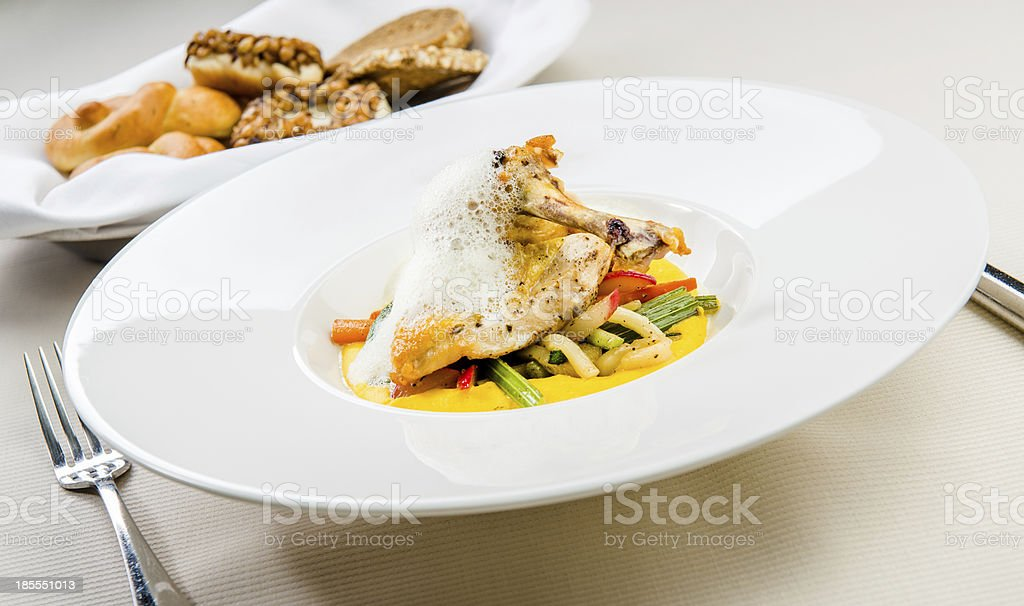 Crispy chicken breast and garnish royalty-free stock photo