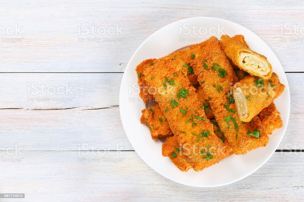 Crispy Chicken cheese breaded wraps on plate stock photo