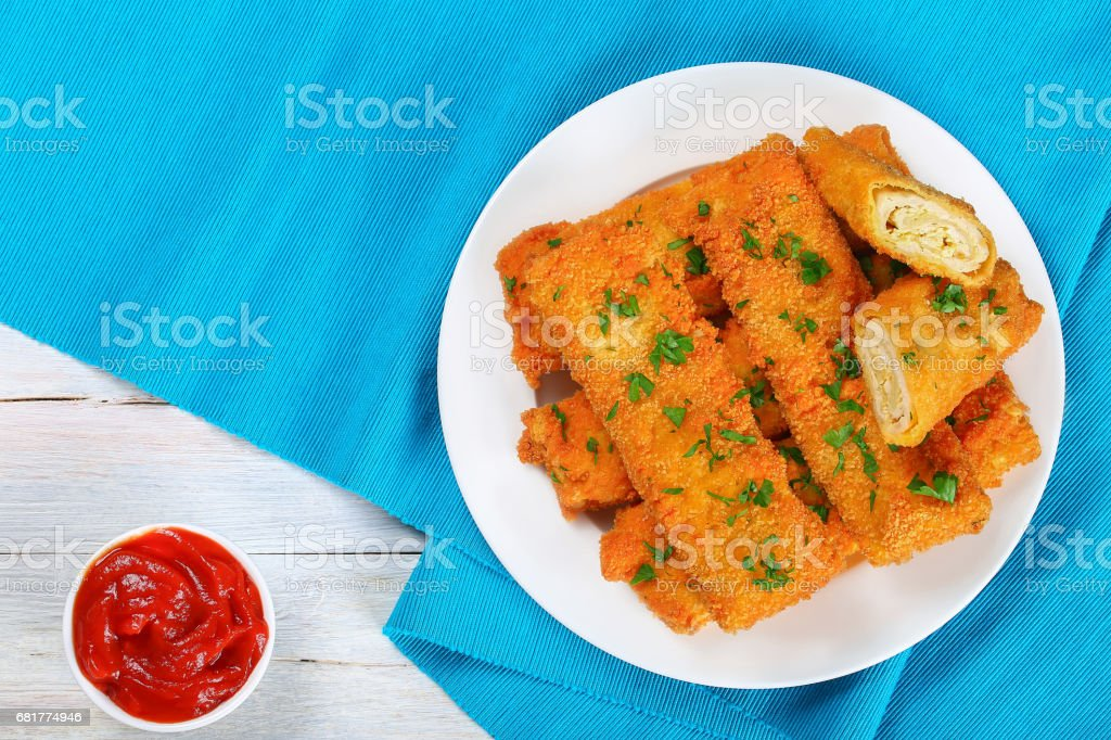Crispy Chicken cheese roll-ups, top view stock photo