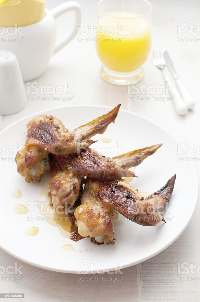 Crispy chicken wings with orange sauce royalty-free stock photo