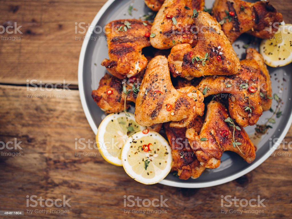 Crispy chillie sprinkled chicken wings on a plate stock photo