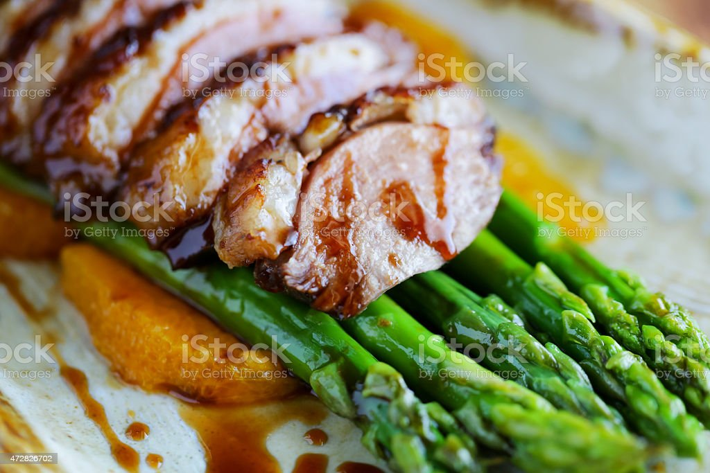 Crispy duck with asparagus stock photo