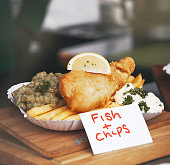 Crispy fish and chips with peas and lemon, street food