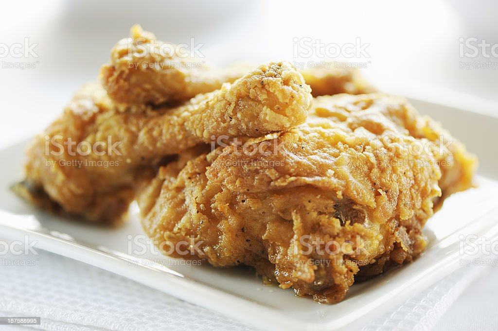 Crispy fried breast and legs from chicken stock photo