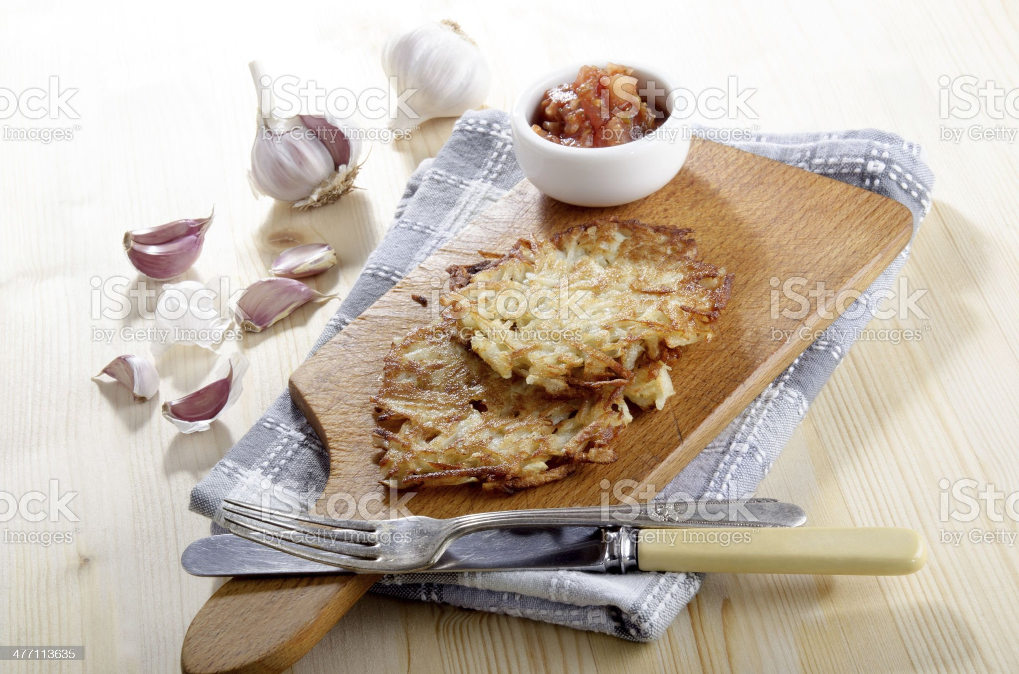 crispy hash browns on a wooden board royalty-free stock photo