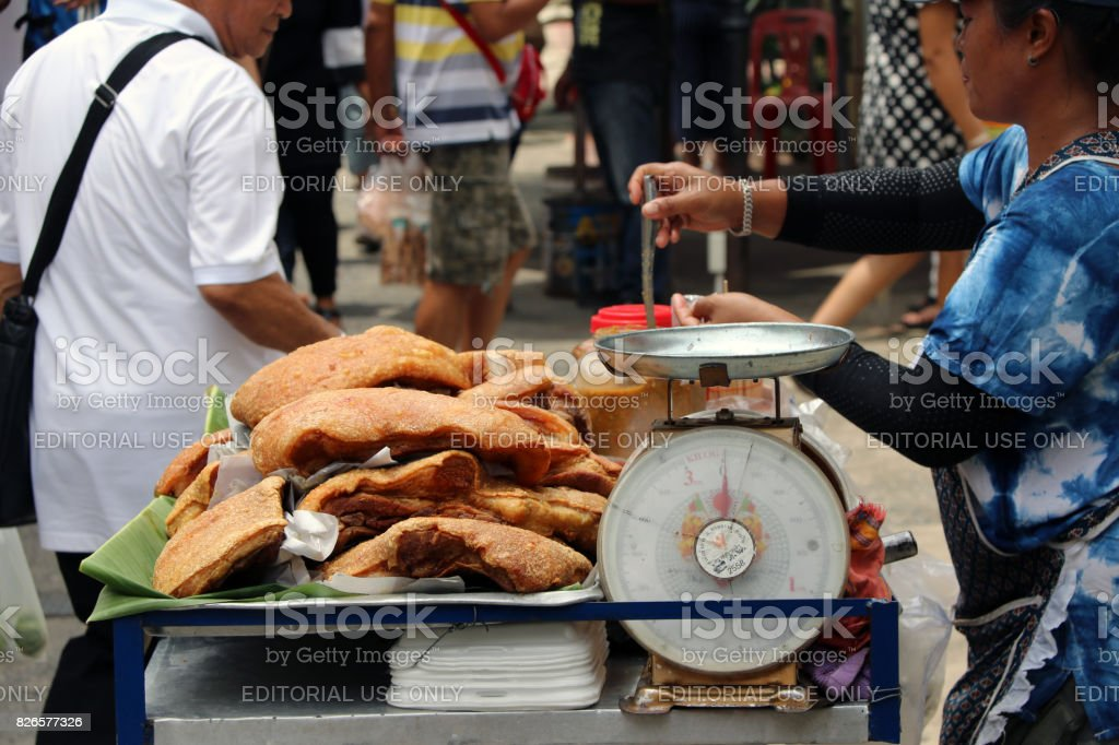 Crispy pork knuckle sold on the cart at street market. stock photo