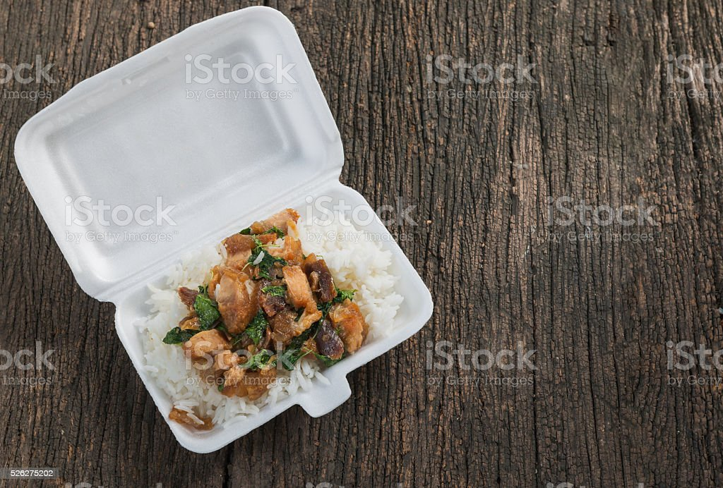Crispy pork with Basil fried rice in foam box stock photo