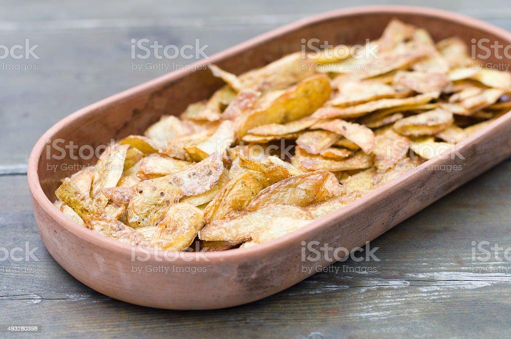 Crispy potato skins in crockery stock photo