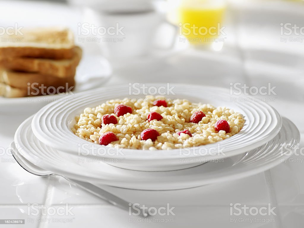 Crispy Rice Breakfast Cereal with Raspberries royalty-free stock photo