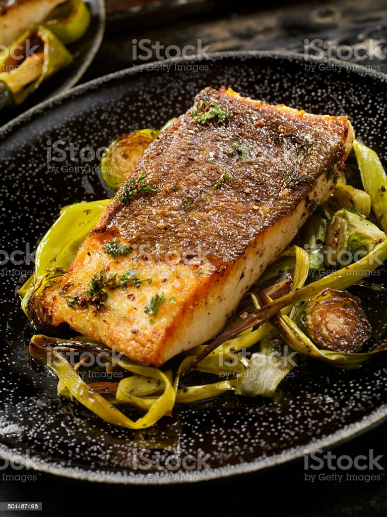Crispy Skin Grilled White Fish stock photo