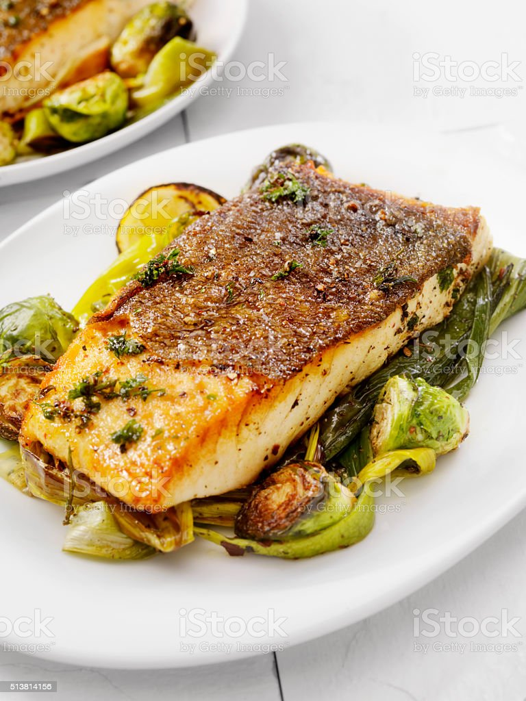 Crispy Skin Grilled White Fish stock photo