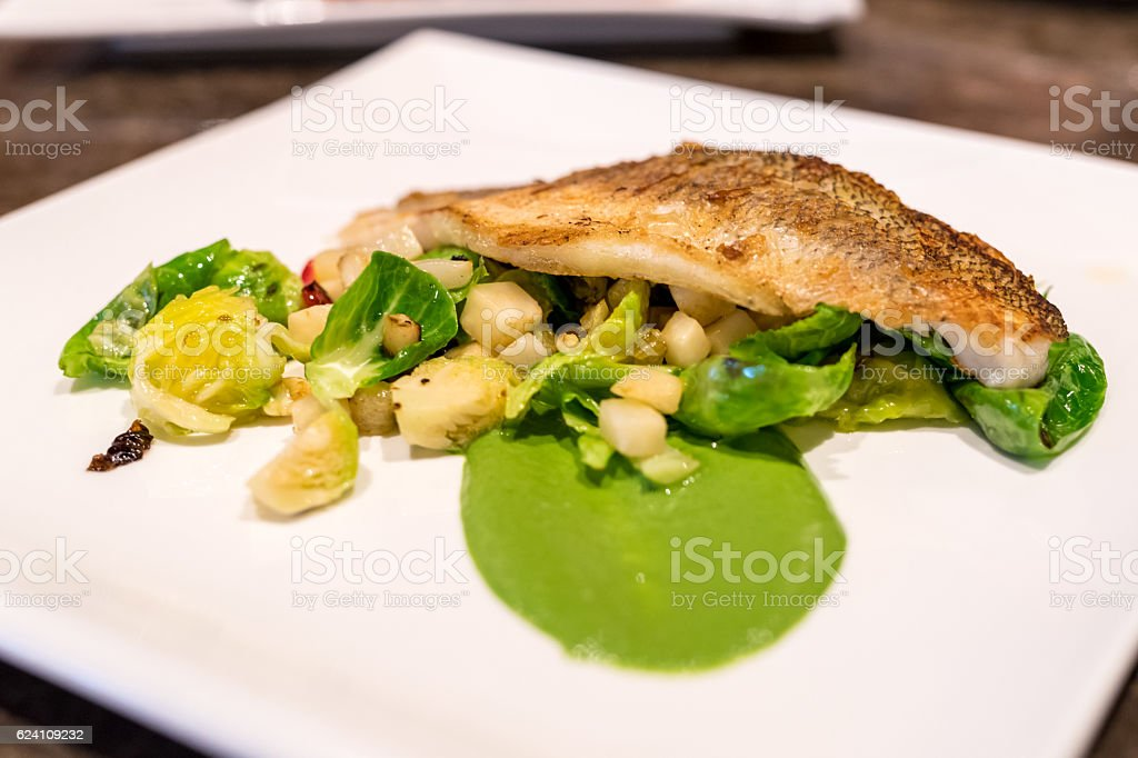 Crispy Skin Grilled White Fish with vegetable stock photo