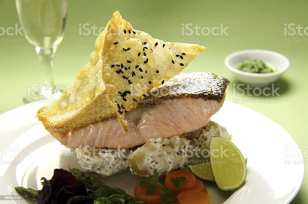 Crispy skin salmon on bed of mustard potatoes royalty-free stock photo