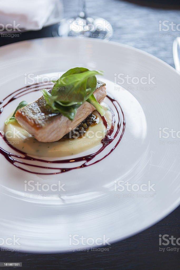 'Crispy skin salmon with parsnip puree, lentils and wine sauce' stock photo