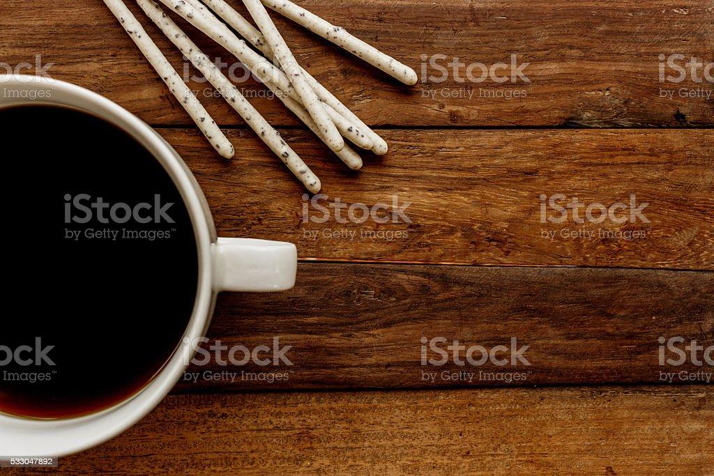 crispy sticks in white glaze and black coffee stock photo