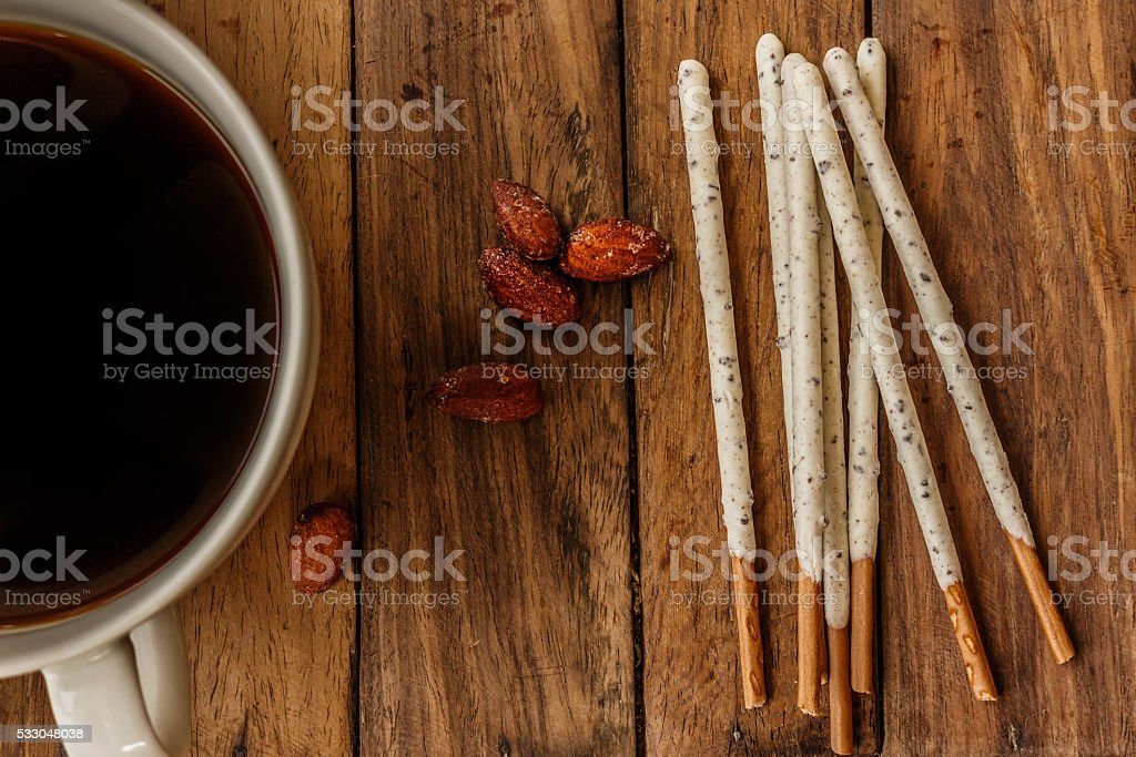 Crispy sticks with white chocolate and almonds complement delicious coffee stock photo