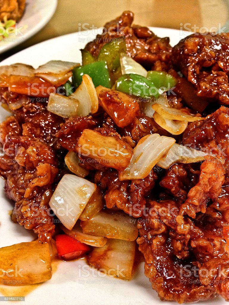 Crispy sweet and sour pork with onion and capsicum stock photo
