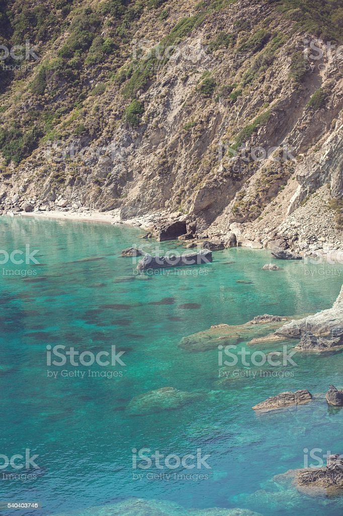 Cristal clear water to swimming in greece stock photo
