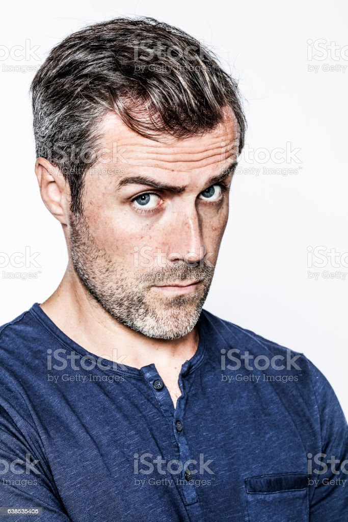 critical middle aged handsome bearded man looking with doubt stock photo