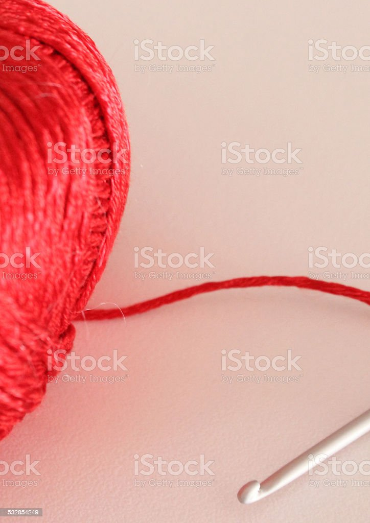 crochet and red cotton stock photo