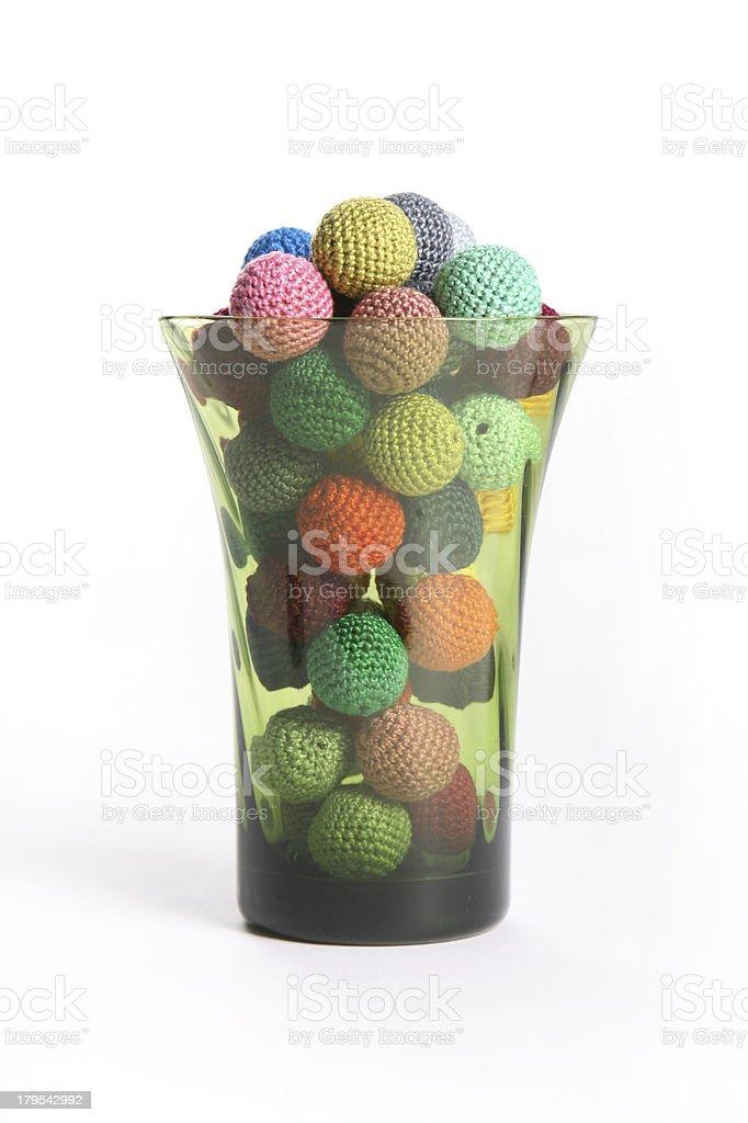 Crochet beads balls in green glass royalty-free stock photo