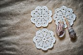 crochet doilies and seashells on a dark old paper background