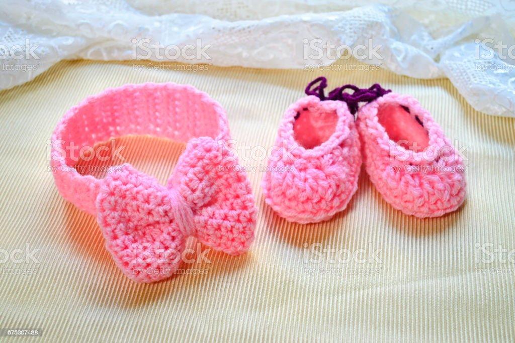 crochet girl headband and shoes stock photo