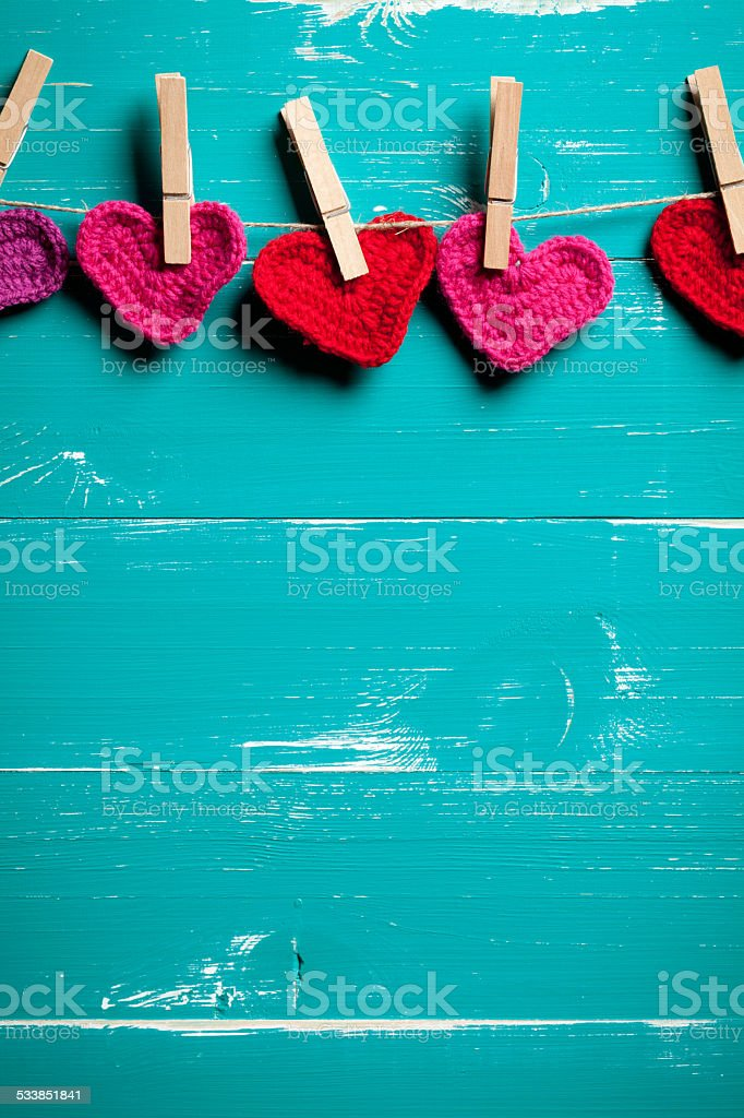Crochet hearts on clothesline stock photo