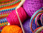 Crochet hook and balls of colored thread