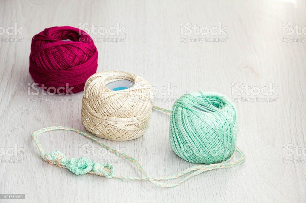 Crochet hooks and balls stock photo