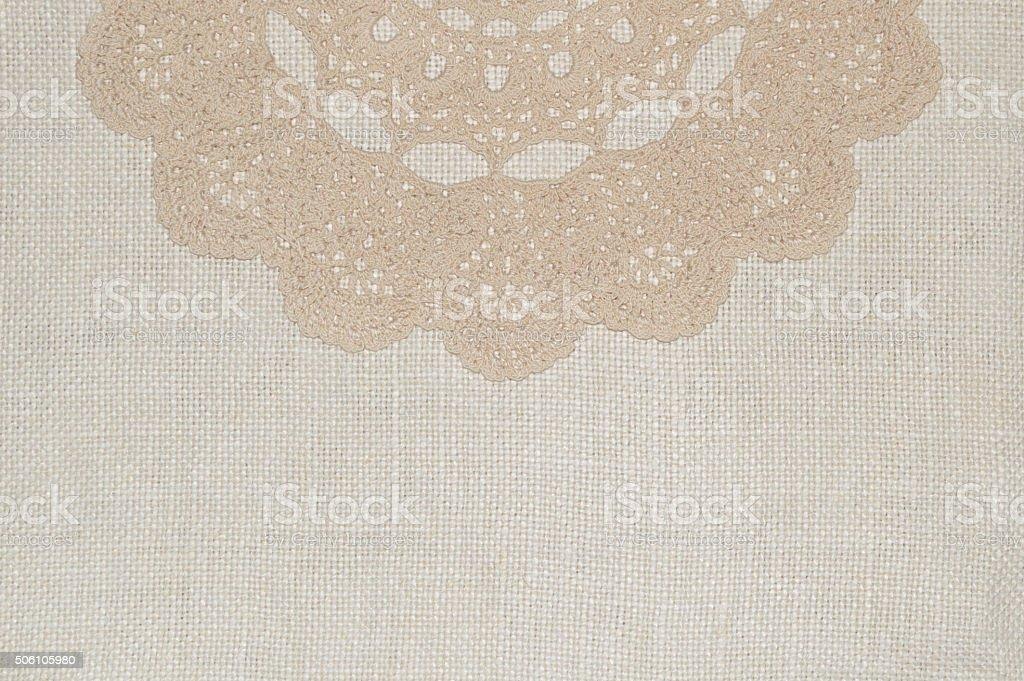 Crochet lace on linen background stock photo