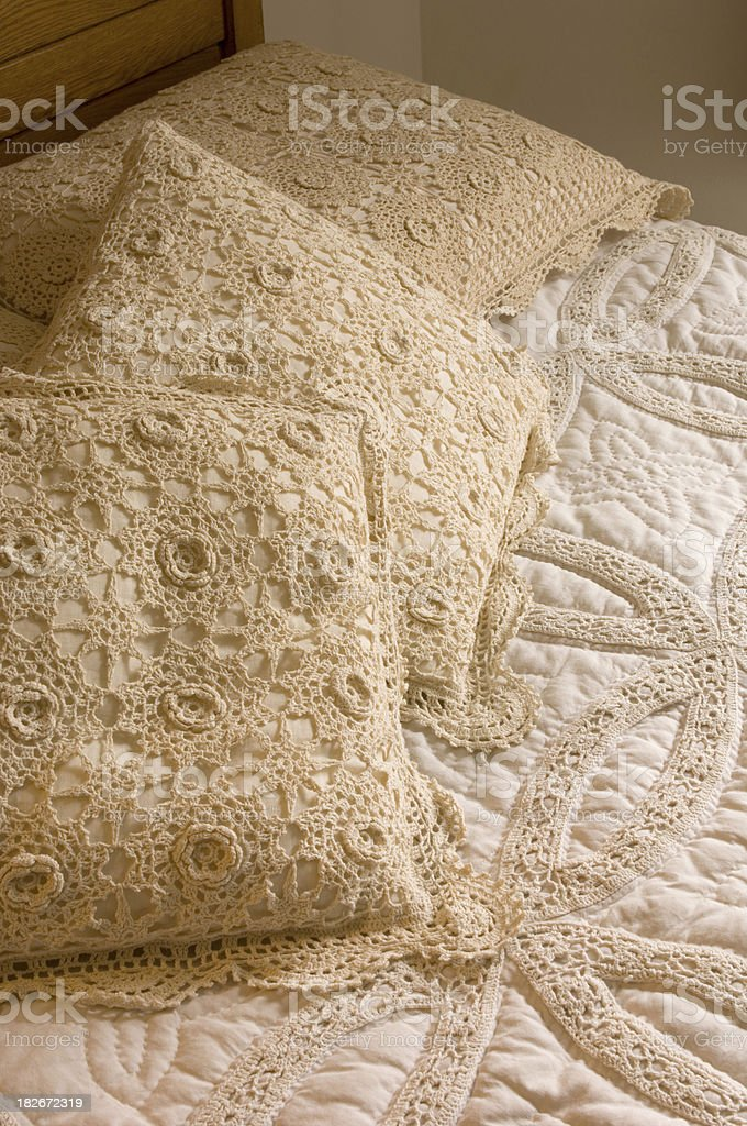 Crocheted Bedspread and Pillow Shams stock photo
