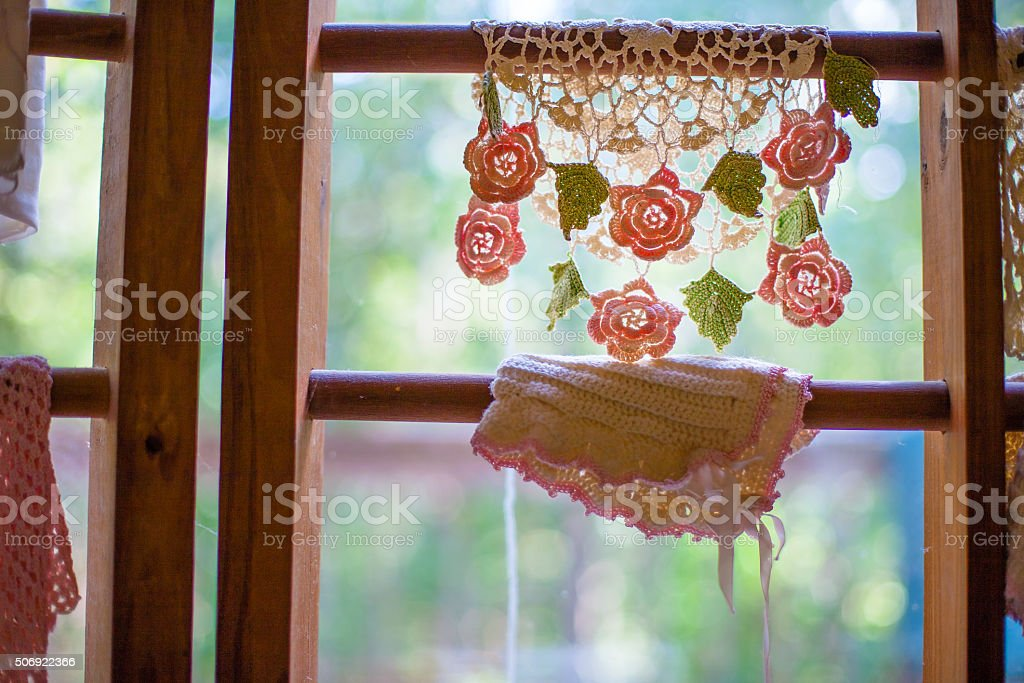Crocheted Flower Design Lace Draped Over Wood In Window Sill royalty-free stock photo
